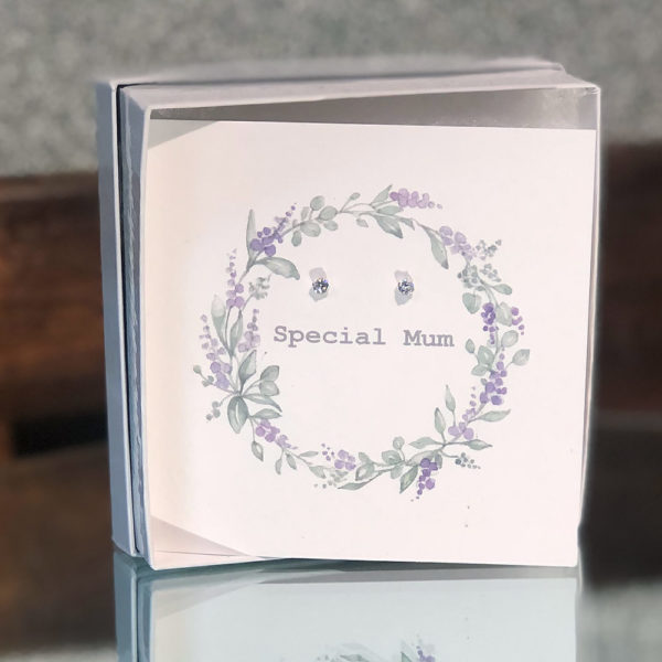 Pair of sterling silver studs set on a Mother's Day card