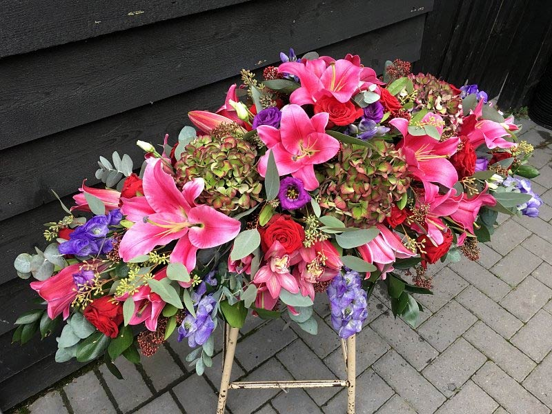 Colourful coffin flower spray