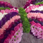 Pink and purple butterfly shaped funeral tribute