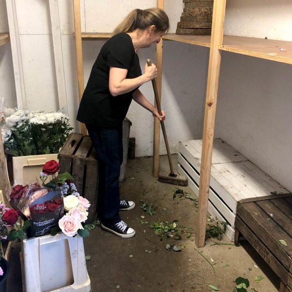Florist ceaning out the store room