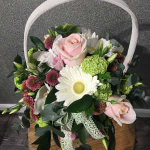 A pretty basket with pastel coloured flowers