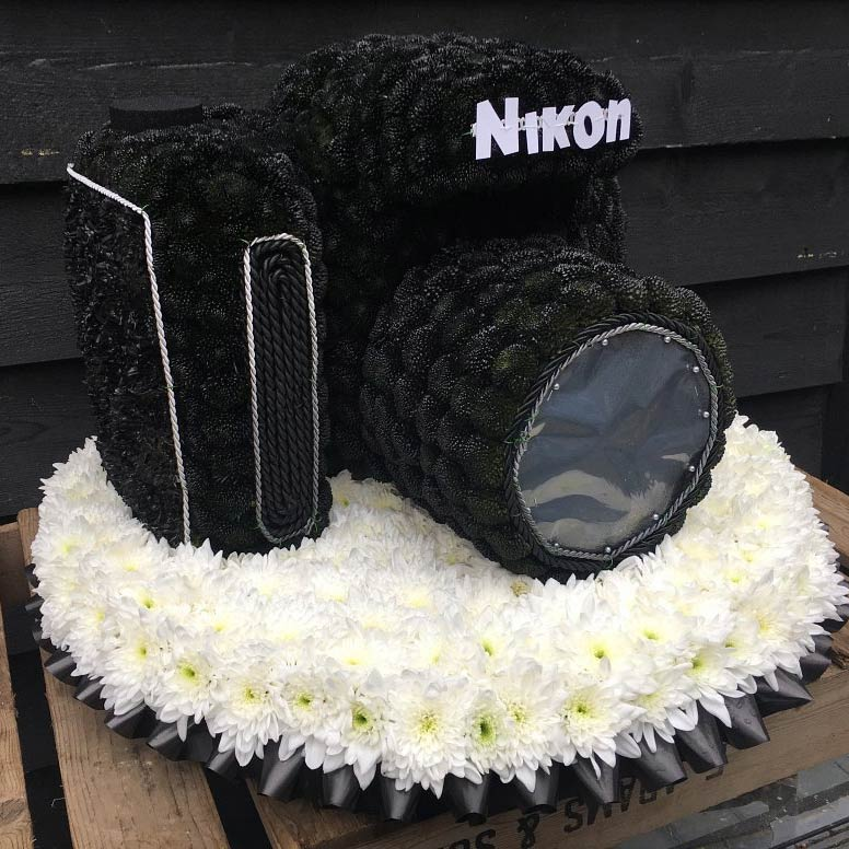 SLR camera shaped funeral tribute