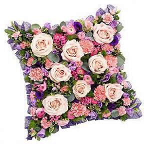 'Loose cushion in pinks and lilacs