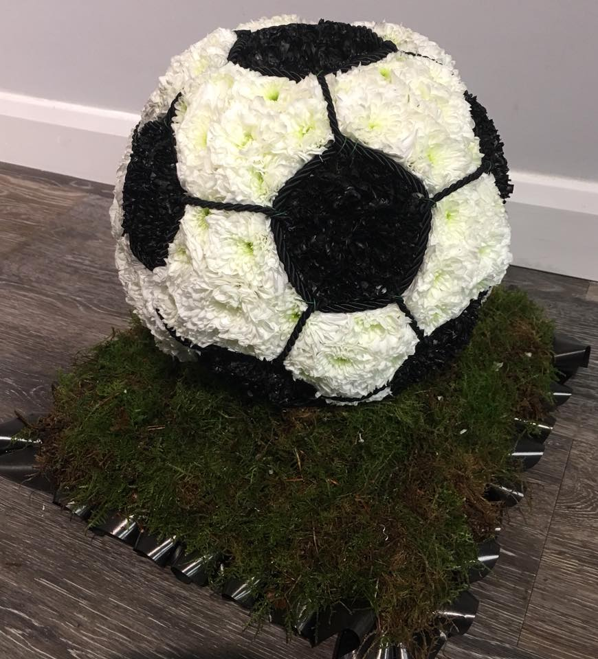 Funeral tribute in the shape of a Football