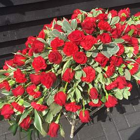Red rose and red carnation spray