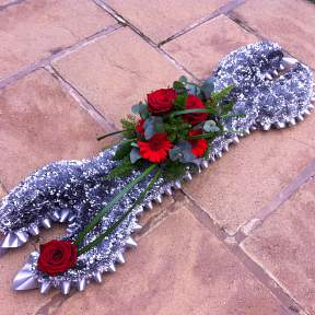 Funeral tribute in the shape of a Spanner