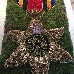 funeral tribute in the shape of the Burma Star