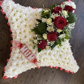 Red and ivory cushion